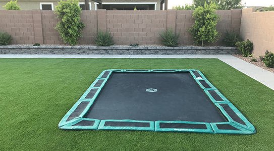 In-ground trampoline flush to backyard and seamless design