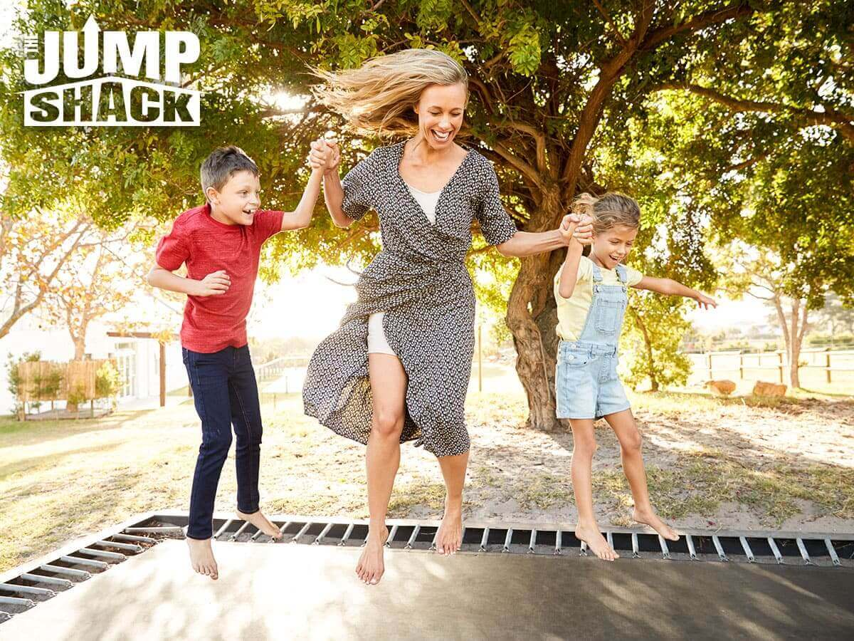 Happy Family Having Safe Fun On An In-Ground Trampoline In Gilbert